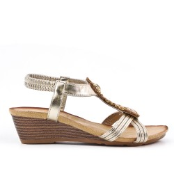 Golden sandal with small wedge