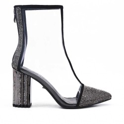 Black ankle boot decorated with rhinestones with transparent detail