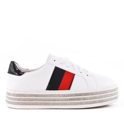 White tennis shoe with rhinestone sole