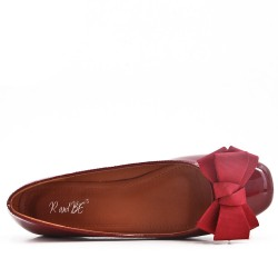 Red ballerina in bow nail polish