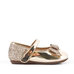 Golden girl ballerina with glitter bow