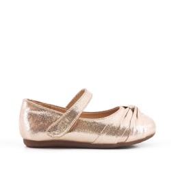 Golden girl ballerina with glitter bow