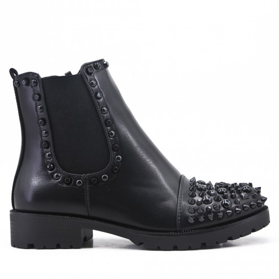 Black imitation leather ankle boot with studs on the tip