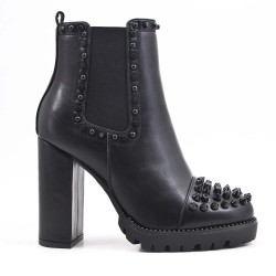 Boot with studs and heel