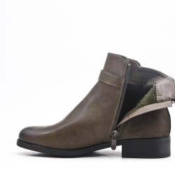 Green leather ankle boot with buckled bridle