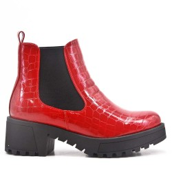 Red ankle boot with elastic inserts
