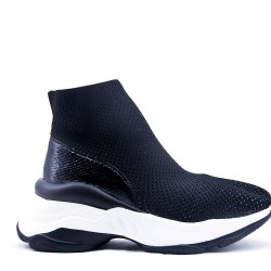 Flat ankle boot in a mix of materials For autumn and winter
