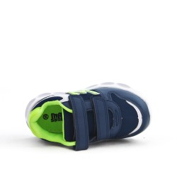 Blue child sneaker with luminous sole