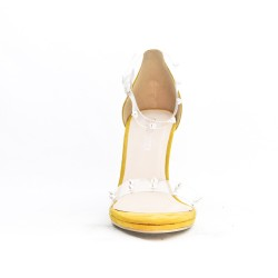 Yellow sandal with transparent detail decorated with nails