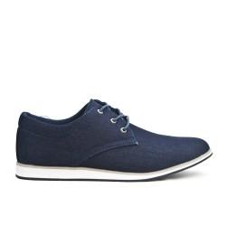 Zapato de mezclilla azul con encaje