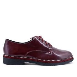 Red derby in laced lacing
