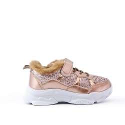 Golden lace-trimmed basketball shoe