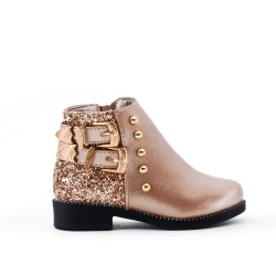 Golden girl's boot with buckled bridle on the side