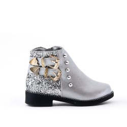 Silver girl's boot with buckled bridle on the side