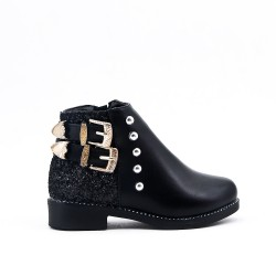 Black girl's boot with buckled bridle on the side