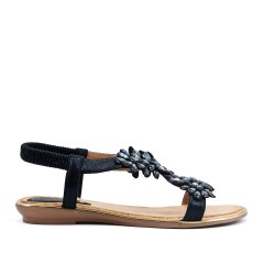 Black sandal with large flowers