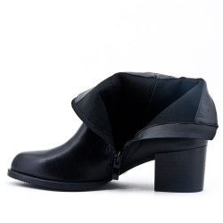 Black leather ankle boot with buckled bridle