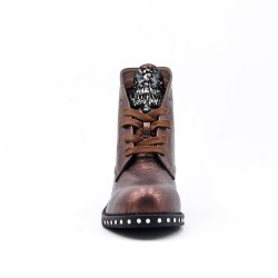 Tan boot with rhinestones on the tongue