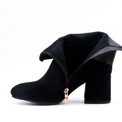 Black ankle boot with buckled bridle