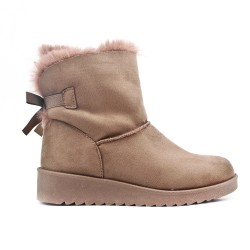 Beige stuffed boot with bow at the back