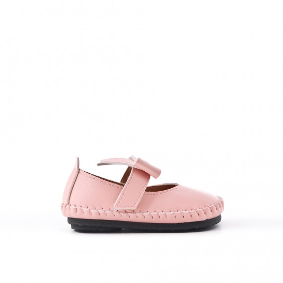 Babies pink girl in imitation leather