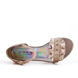 Girl's golden sandal with shuttlecock