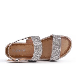 Silver sandal decorated with rhinestones