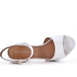 White sandal in varnish